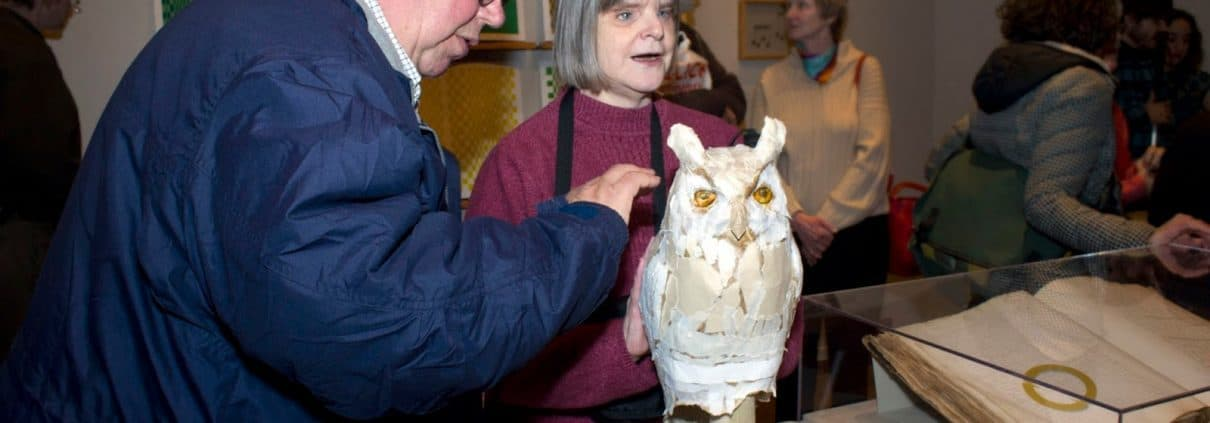 Reception, Common Touch: The Art of the Senses in the History of the Blind. Two visitors interact with a sculpture of an owl.