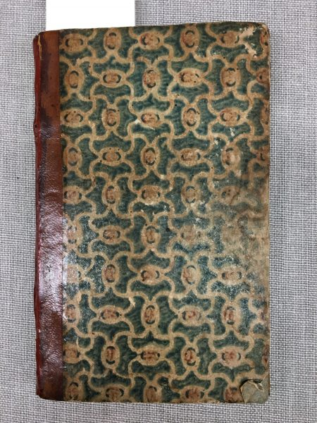 Block-printed decorated papers are used on the covers of these books.
