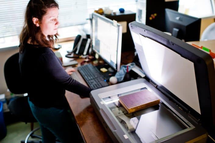 Concetta Barbera, Digital Outreach Librarian and Curatorial Assistant, scanning a book in the Library Company Digitization Department.