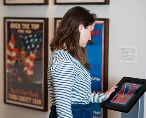 Visitor viewing digital collections on an iPad in the Louis Lux-Sions and Harry Sions Gallery at the Library Company of Philadelphia.