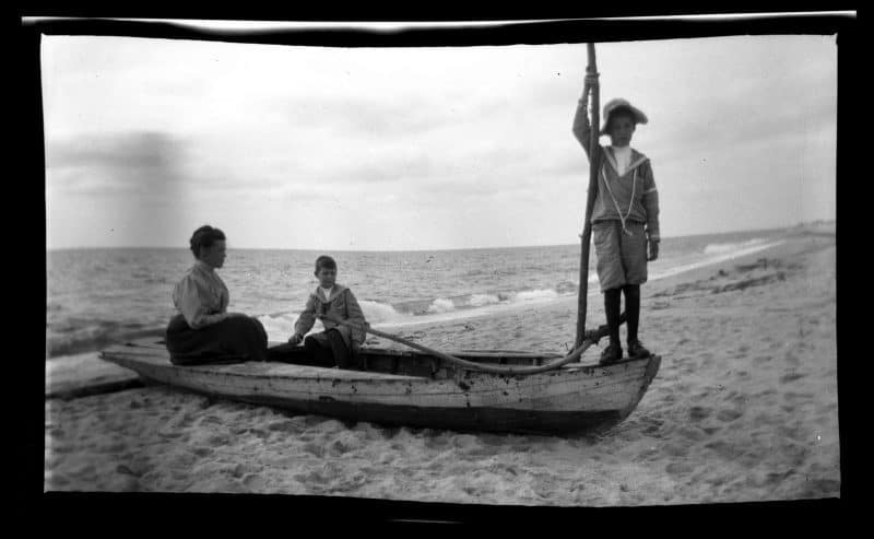 Two boys and woman in boat, Sea Girt Marriott C. Morris Collection [P.2013.13.82]