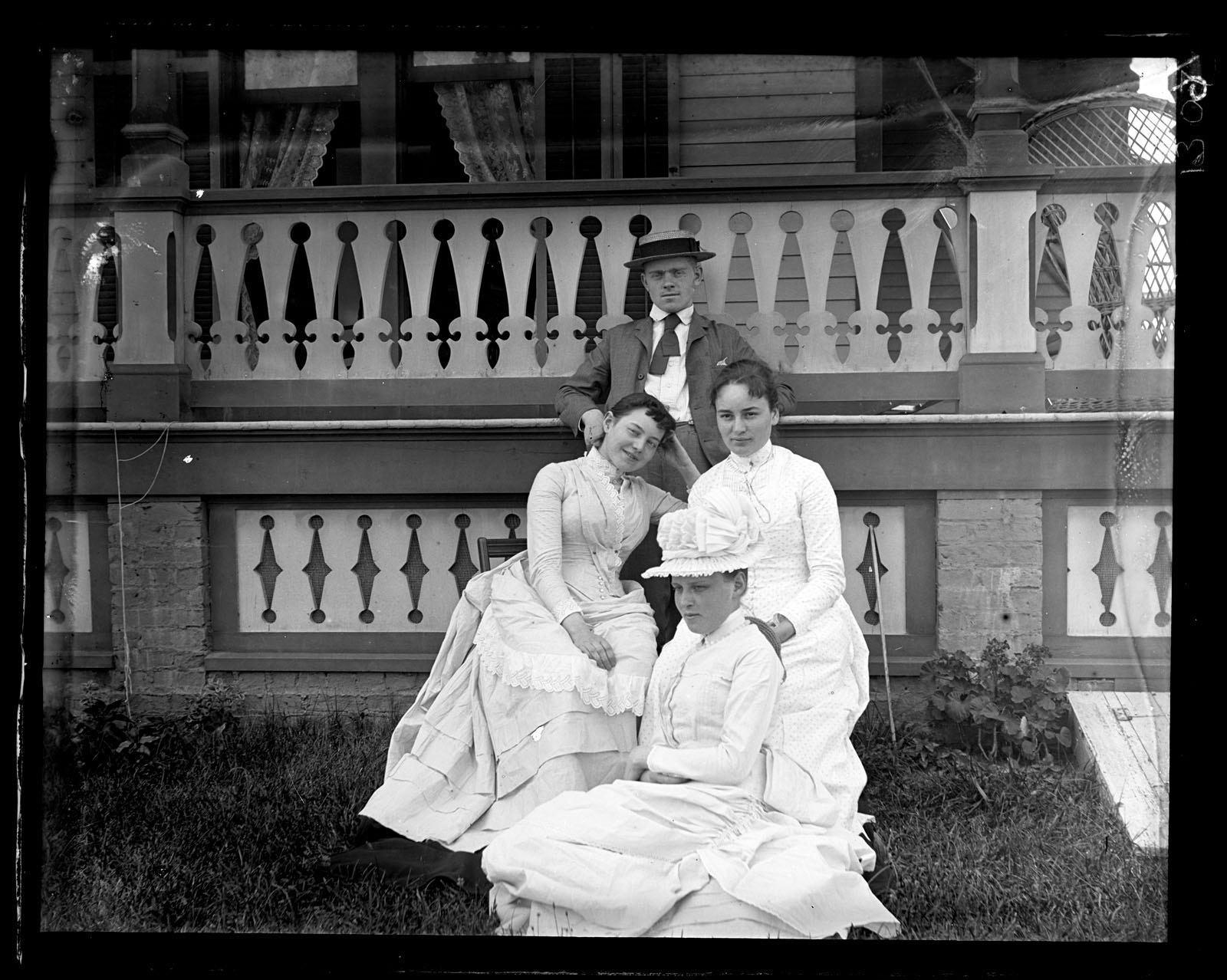 Morris, Marriott Canby, 1863-1948, photographer. Group in front of our cottage [Avocado, Sea Girt]. Bess, Helen Morris, Fannie Garrett & Fred Strawbridge. July 8, 1888.