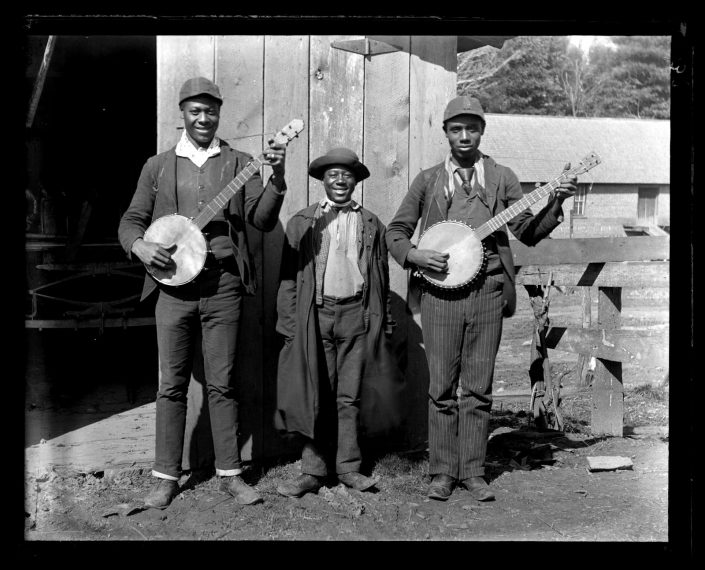 [Three] Colored Boys with Banjos Back of Swannanoa Hotel. Asheville, [NC], 1890. Glass negative. Marriott C. Morris Collection.
