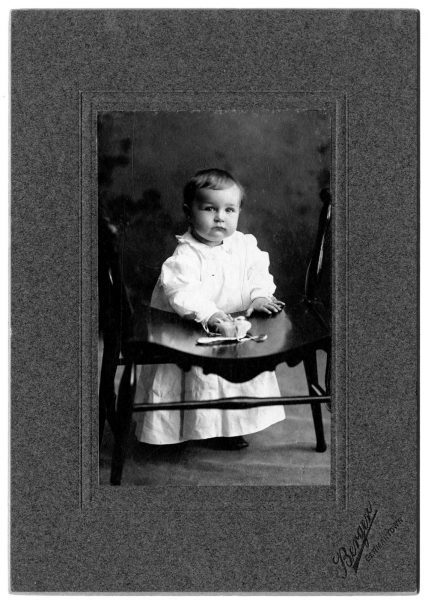 Portrait of Elliston Morris Jr. as a baby, wearing a long white dress.