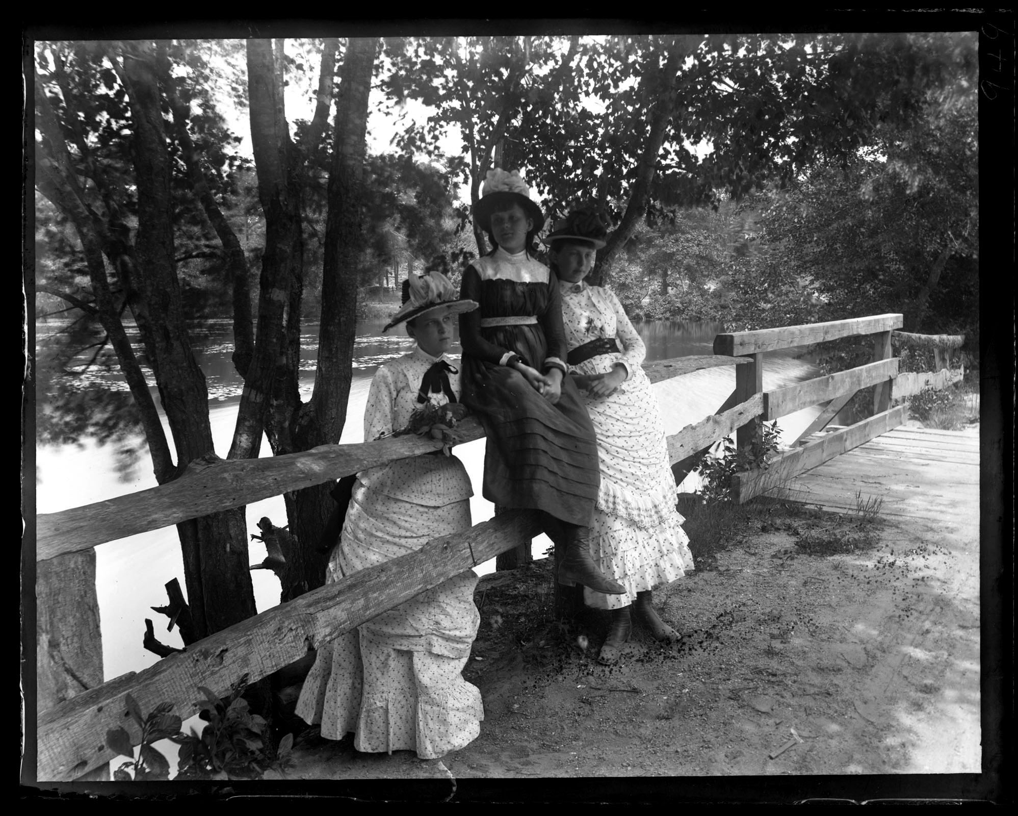 Marriott Canby Morris. Bella & Edith Wistar & B[ess] C. M[orris] by Fence in Front of Mill. [Sea Girt, NJ], 1886. Glass negative. Marriott C. Morris Collection. [P.9895.949]