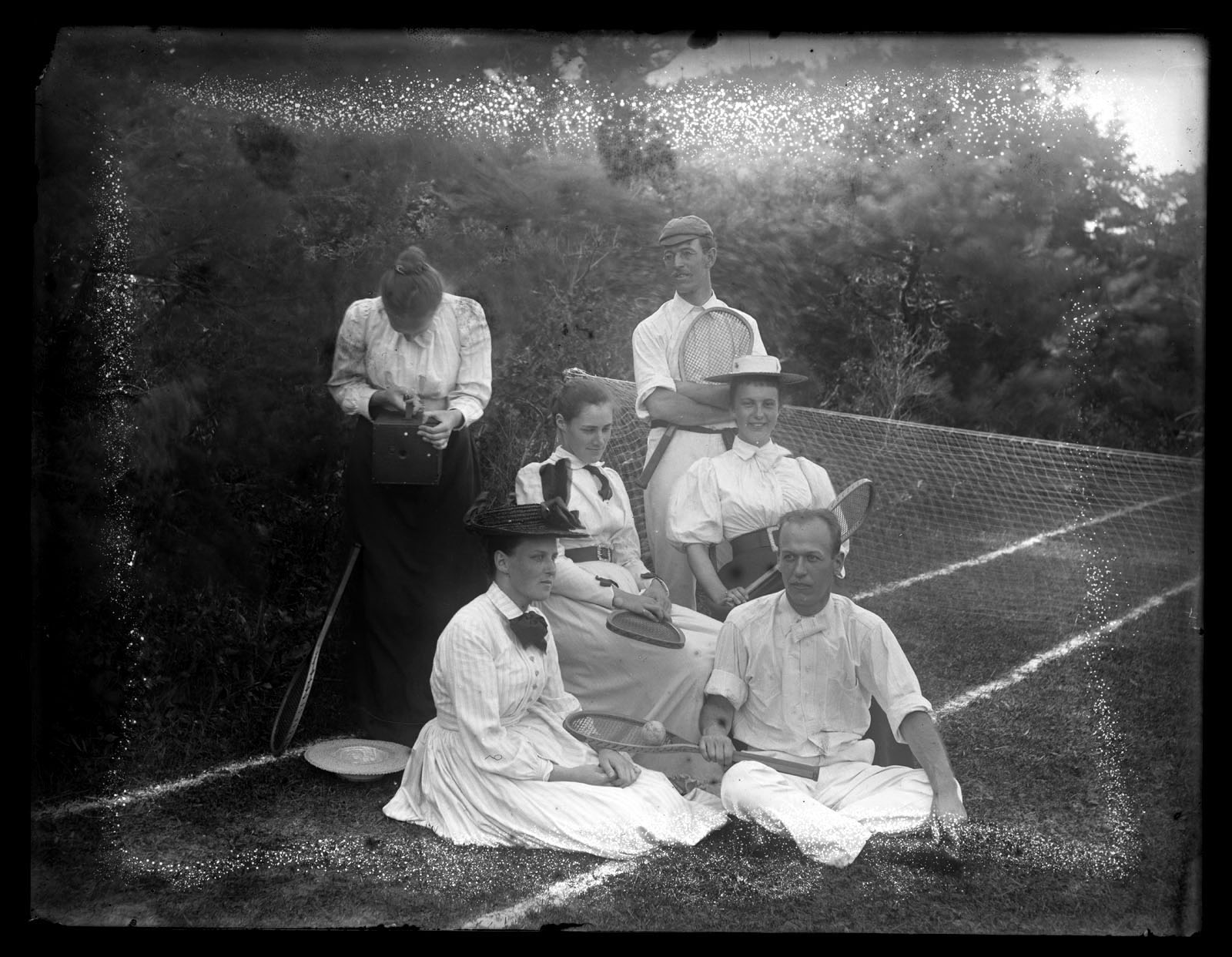 Marriott Canby Morris. [Tennis Party Including Bess Morris and Woman with a Camera], ca. 1880-ca. 1900. Glass negative. Marriott C. Morris Collection. [*P.9895.12.7]