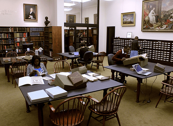 A photo of the Library Company of Philadelphia first floor Reading Room filled with researchers.