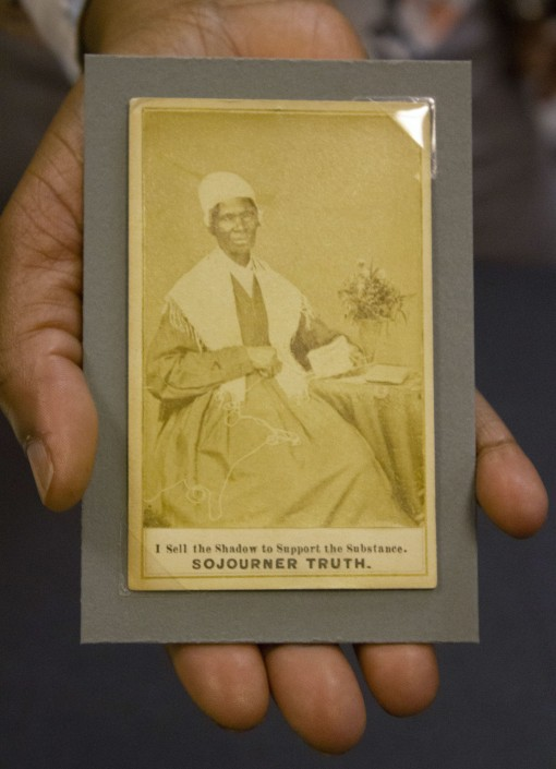 Jasmine Smith, LCP African American history subject specialist, holds a rare trading card type photo of abolitionist speaker Sojourner Truth.