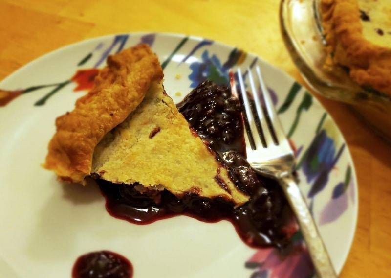 Slice of cherry pie, served