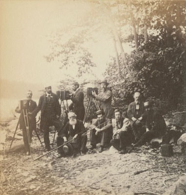 John Browne, Photographic Society of Philadelphia at Hopatcong Lake, albumen photograph, 1880. Society members are posed with their cameras. Four are standing while five are seated.