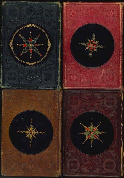 Back covers of Leavitt & Allen gift books with papier-mâché medallions.