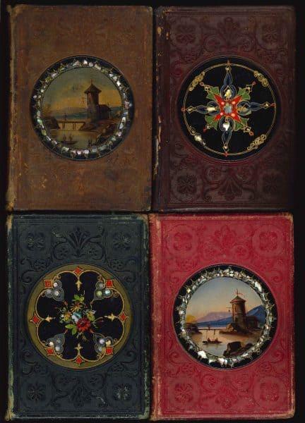 Front covers of Leavitt & Allen gift books with papier-mâché medallions, 1852-1853.