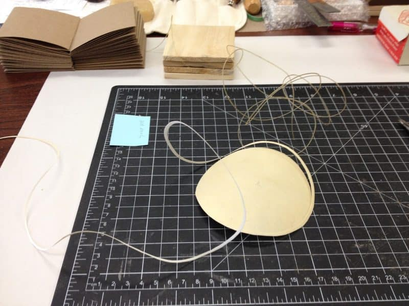 Thread being made from thinly-cut parchment.