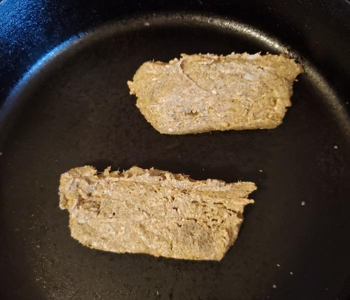 Sliced scrapple frying